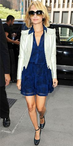 Nicole Richie in a ruffled Marc Jacobs jacket layered over a Winter Kate print dress.