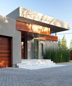 The modern home in the burbs answer to Falling Waters' entry. Love the grasses adding to the strong vertical lines against the strong horizonals.