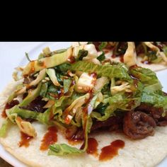 Bulgolgi tacos spicy slaw and gochujang sauce!