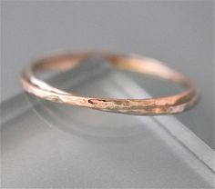 Two thin 1mm 14k solid gold rings hammered, soldered together and interlocked forever. Each ring is handmade and formed by me for you. I can make this ring in any size, 1/2 size or 1/4 size. Please feel free to contact me if you are looking for a similar ring in a thicker gauge. You