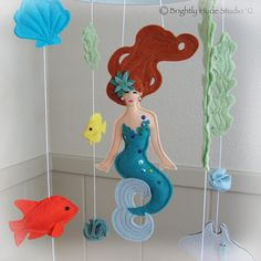 Hey, I found this really awesome Etsy listing at http://www.etsy.com/listing/112236007/magical-mermaid-felt-mobile