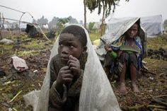 Waiting for aid    Internally displaced Congolese children shelter from the rain under plastic sheets Aug. 8 as they await aid in Kibati, north of Goma, eastern Congo. Drenching rain punctuated by frightening bursts of thunder and forked lightning add to the misery of some of the 280,000 refugees from Congo's eastern rebellion. Their plight was highlighted by a visit from the U.N. humanitarian chief Baroness Valerie Amos