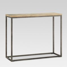 Display your favorite photos and accent pieces with industrial style on the Wood and Metal Console Table from Threshold™. With a light pine top and iron frame, this mixed materials console table brings sleek, minimalist style to any room. Set it up in your living space or office to show off your family pictures or industrial-inspired antique lamps.