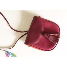 "Mywalit mini flap over tassel bag The color is ""Berry Blast."" Has a long adjustable strap. Magnetic snap closure. Internal zipper pocket. Mywalit elephant logo on internal zipped pocket and embossed on the back. Mywalit Bags Crossbody Bags"