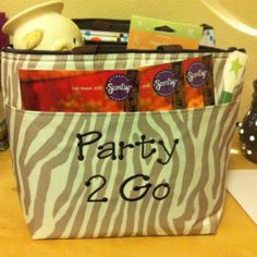 "Don't have time to have a party? Take it to work! In this ""Party 2 Go"" bag it's perfect for you to take to share with family/ friends. It includes catalogs, Scentsy Plug-in, Scents, Scentsy Scent Circle/Travel Tin, and more. The BEST part is, you get the hostess credits and you didn't have to clean up your house:0)"
