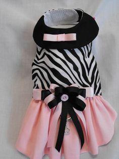 Very sweet dress if you like zebra prints. Top of dress is black & white…