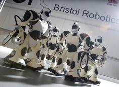 Miniature robots stand in a group at the Bristol Robotics Laboratory. World Problems, Robotics, Research, Bristol, Miniatures, Technology, Group, Search, Tech