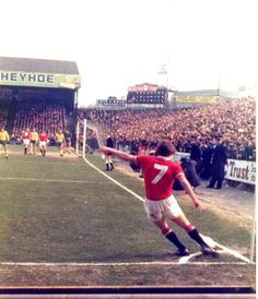 Steve Coppell shows perfect form taking a corner at Carrow Road in 1977.