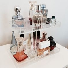 Showcase your beautiful perfume collection! The 2 tier acrylic perfume tray is the perfect way to display and organize all your stunning perfumes. It takes up minimal space on your vanity and can store up to 15 full size perfume bottles. Handmade with AA grade new acrylic. Some assembly is required (screwdriver needed) Perfume Holder Overall H 8 Top tray: 9.5 x 5 x 1 Bottom tray: 11 x 6 x 1