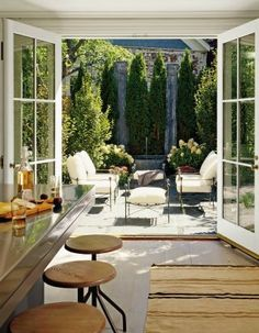 Designer Michael Lee raised the ceilings of a Second Empire–style townhouse in Sag Harbor, New York, from seven to nine feet, removed a fireplace and a pantry, and installed French doors that open onto the rear courtyard. The landscaping was done by Mario Nievera.