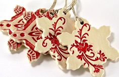This ceramic snowflake ornament was handmade one at a time...from a slab of B-mix clay, which is a combination of stoneware and porcelain. I brushed on 3 coats of red underglaze, then washed it off with my sponge...leaving the red in the recessed areas. Then glazed the top and sides with a non-toxic zinc free clear glaze. Then fired it to 2165 degrees (cone 5) in my electric kiln. This beautiful handmade Snowflake Ornament will last for generations. Its approximately 3 1/2 x 3 ...
