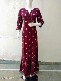 Kurta Sets Women's Printed Rayon Kurta with Sharara Fabric: Kurti - Rayon Sharara - Rayon Size: Kurti - 38 in 40 in 42 in 44 in Sharara - 28 in 30 in 32 in  34 in Length: Kurti  - Up To 46 in Sharara - Up To 39 in Type: Stitched Description: It Has 1 Piece Of Women's Kurti & 1 Piece Of Sharara Color: Maroon Work: Kurti - Printed Sharara - Printed Country of Origin: India Sizes Available: 38, 40, 42, 44   Catalog Rating: ★4.2 (275)  Catalog Name: Women Rayon A-line Printed Long Kurti With Palazzos CatalogID_512313 C74-SC1003 Code: 866-3671407-6771