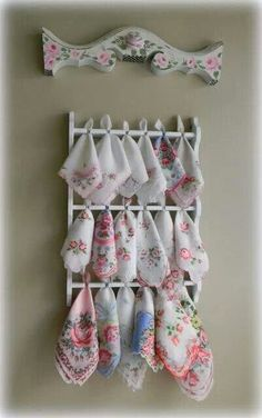 What a great way to show a collection of beautiful vintage handkerchiefs! This old spoon rack has been put to great use.
