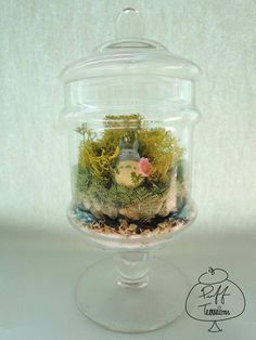 Blooming Totoro Terrarium in Candy Jar- (8cm.L x 16cm.H)  What's cuter than a Totoro surrounded by flowers? Place this mini candy jar at your office for a sweet treat everyday!  https://www.facebook.com/puffterrariums