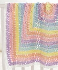Using fun colors like sunshine, light country peach, orchid and other soft colors will make you feel like you're on a cloud while working up the Beginner Daydream Baby Blanket. This crochet blanket pattern is great for those ju. Crochet For Beginners Blanket, Baby Afghan Crochet, Manta Crochet, Baby Afghans, Baby Blankets, Crochet Blankets, Crochet Ripple, Basic Crochet Stitches, Crochet Basics