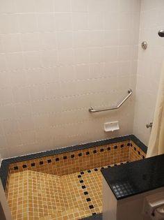 sunken tile bathtub/shower
