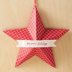 Add a festive message to your Christmas tree with our fun-to-make three-dimensional paper star ornament. http://www.bhg.com/christmas/ornaments/easy-christmas-ornaments/?socsrc=bhgpin122214starchristmasornament&page=10