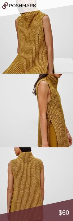 Aritzia Wilfred Durandal Sweater This sleeveless mockneck is knit with an alpaca blend that is soft and  warm. It is designed with a roomy funnel neck and an slit at the hem. The silhouette works well on its own, or as an incredibly versatile layering piece. Aritzia Sweaters Crew & Scoop Necks