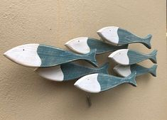 Decorative wooden fish - hanging fish ornaments ideal as decoration in a fish restaurant, bunches of hanging fish, wooden school of fish art and other fish themed decorative items including decorative fish, silver metal fish, ceramic fish and metal fish wall hangings.