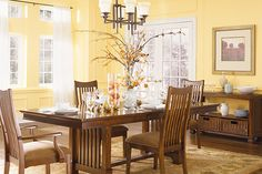 Interior Design Ideas - Warm & inviting Dining Room Colors : Warm dining room colors give off an inviting vibe to guests. Turning Oakleaf PPG1107-3 is a buttercream yellow paint color that looks beautiful in a dining room paired with a soft white like Linen Ruffle PPG1075-1. Find tables and chairs in Salted Pretzel PPG1077-6 and decor and accents in Mecca Gold PPG1209-7 to add depth and color to the room.