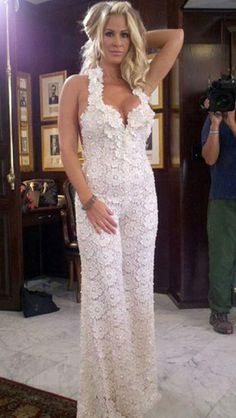 Real Housewife of Atlanta, Kim Zolciak's third wedding dress of the evening was a lace jumpsuit by Pnina Tornai.