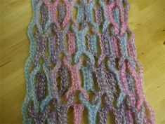 Cute idea for scarves or afghans. No instructions, only photos. It looks simple though. Make a chain, then single crochet back along it with loops made from chains. Then repeat with another colour. This might look sweet as a stash buster.