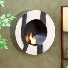 @Overstock.com - Round Stainless Steel Wall-mount Fireplace - This round stainless steel wall mount fireplace is the ideal addition to a contemporary living room. Since it burns FireGlo gel fuel or scented candles, there's no need for a chimney. This fireplace is a quick and sophisticated addition to any home.  http://www.overstock.com/Home-Garden/Round-Stainless-Steel-Wall-mount-Fireplace/4042653/product.html?CID=214117 $233.99