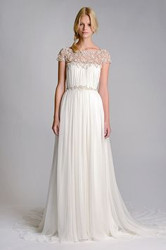 Gorgeous cap sleeves and an embellished neckline is both elegant and unique,