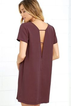 Take a mini vacation every time you slip on the Mumbai the Way Washed Burgundy Shift Dress! Soft and sleek woven fabric shapes short sleeves, rounded neckline, and straight-cut bodice with darting. The effortlessly cool silhouette gets a sultry peek of skin at back, thanks to a strappy V cutout.
