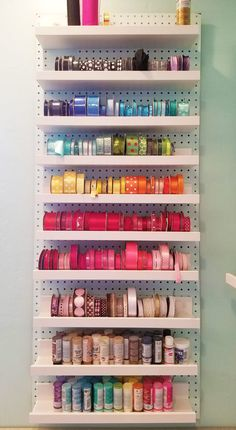 Ribbon Storage Organizers, Racks, & Shelves Ribbon storage on a wall: ribbon spools can be put on shelves on a pegboard to organize them!Ribbon storage on a wall: ribbon spools can be put on shelves on a pegboard to organize them! Ribbon Organization, Small Space Organization, Craft Organization, Storage Organizers, Craft Room Storage, Wall Storage, Craft Ribbon Storage, Pegboard Storage, Craft Rooms