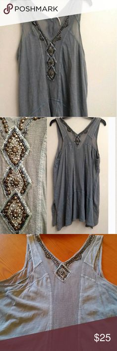 Free People Jeweled Tunic Free People tunic with embellishments.  Small run in back (3rd image) not overly noticeable. No beading missing. This is a reposh, didn't fit as I would like so never worn  Color is a grayish blue Free People Tops Tunics