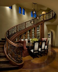 Unusual dining in Phoenix. IMI Design. I like the under the stairs shelving/cabinetry.
