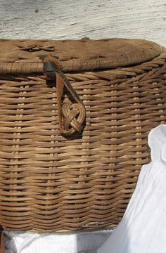 """basket with leather closure loop to put around woven basket """"knot"""" cool design"""