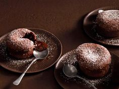 Molten Lava Cakes Recipe : Patrick and Gina Neely : Food Network; of chocolate, and two sticks of butter in SIX servings. Star Chocolate, Chocolate Lava Cake, Chocolate Desserts, Chocolate Fondant, Chocolate Heaven, Flourless Chocolate, Decadent Chocolate, Chocolate Pudding, Köstliche Desserts