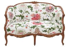 """Louis XV Floral Settee - A Louis XV style settee made of walnut. Newly upholstered in Brunschwig & Fils Parisian Chinz polished cotton in front with Kravet's striped cotton fabric in the back. The frame is hand carved with floral bouquets and acanthus throughout lightly accented with gold. Arms, 25""""H; seat, 18""""H. Hand refinished and upholstered by Mission Avenue Studio."""
