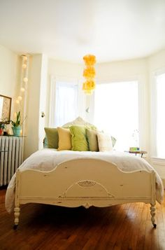 another pastel bedroom with a pop of yellow