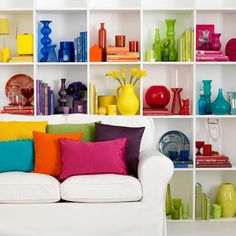 If you have colorful glass and china dotted around your home, try grouping it together by hue. The mixture of glossy vessels gives an almost stained glass effect. For more creative ways to bring color into your home, visit http://www.housetohome.co.uk/room-idea/picture/easy-ways-to-add-colour-10-of-the-best-ideas?slideshow=