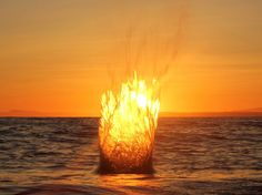 This unedited image was taken with a tripod mounted in the Pacific Ocean during a winter sunset in White Rock, British Columbia, Canada. Taken at the moment a rock was thrown into the water by Rob Leslie via National Geographic. Sunset Pictures, Cool Pictures, Cool Photos, Sunset Images, Sunset Pics, Ocean Sunset, Interesting Photos, Beautiful Sunset, Beautiful World