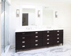 Toronto, ON -Master vanity: recessed chrome pulls, espresso stain on maple, statuario floor tiles.