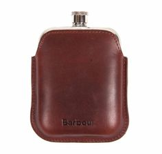 The Barbour waxed leather hip flask is crafted from polished steel and shocases a curved design with an antique finish leather sleeve. Complete with a branded gift box.Polished steel, curved edge hip flask with an antique finish leather sleeve. Boxed.
