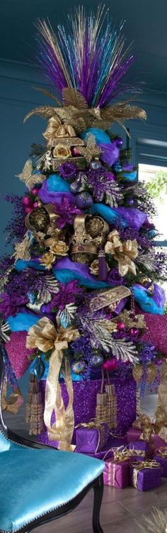 Cristhmas Tree Decorations Ideas : Purple Christmas I like it! Id never do it but the inner artist in me appreciates the creativity in this design. Peacock Christmas Tree, Beautiful Christmas Trees, Christmas Tree Themes, Noel Christmas, Winter Christmas, Christmas Tree Decorations, Christmas 2017, Christmas Crafts, Christmas Photos