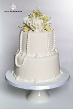 Elegant Ivory Wedding Cake with Pearls and Gardenias