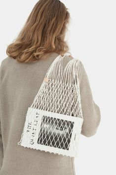 Net Bag is a handmade bag from linen string. It was woven by hand in a small village of Orneta in Northeastern Poland.