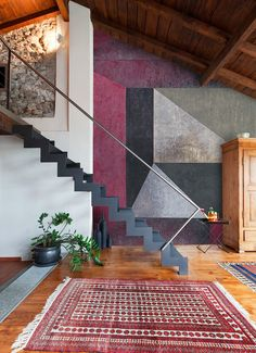 Loving this mix of modern and rustic. Cool staircase!