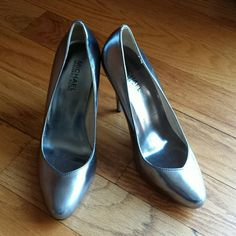 Michael Kors Pewter heels. Need a pair if shoes that will go with everything? then these are them. Total closet staple. I cant wear heels anymore so my loss your fabulous gain. No major scuffs or damage. Great condition.  Worn 2-3 times. MICHAEL Michael Kors Shoes Heels
