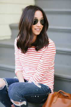 white and red striped shirt and dark ripped jeans