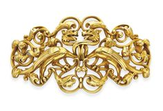 AN ANTIQUE RENAISSANCE-REVIVAL GOLD BELT BUCKLE  Designed as an openwork tapered 18k gold buckle depicting two griffins with foliate and scrolling detail, 19th century, 5 x 2½ ins., with French assay mark and maker's mark