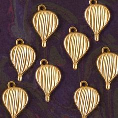 Hey, I found this really awesome Etsy listing at https://www.etsy.com/listing/122077123/set-of-8-small-brass-hot-air-balloon