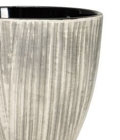 Natural white/charcoal gray. Stoneware plant pot with a texture-patterned finish. Height 5 1/2 in., diameter at top 5 3/4 in.