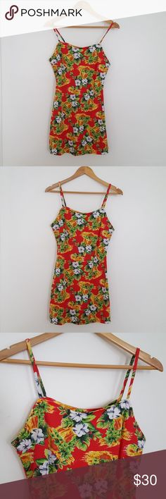 """Vintage Hawaiian Floral Mini Slip Dress Vintage slip style Hawaiian mini dress with spaghetti straps. Pattern is most floral with either a waterfall or lava motif. Polyester and spandex blend fabric has a flattering stretch and has a slight flair after it hits the waist. Marked size large, but closer to a modern small/medium. 33"""" long, 15.5"""" across the waist, and 17.5"""" across the bust. See last pic for small imperfection on the back of the dress. Vintage Dresses Mini"""